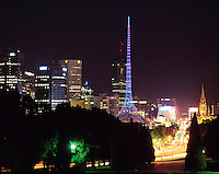 Melbourne Art Centre spire at night with city behind.<br />