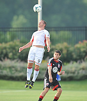 Chad Barrett (9) of the New England Revolution head the ball. D.C. United defeated the The New England Revolution 3-1 in the Quarterfinals of Lamar Hunt U.S. Open Cup, at the Maryland SoccerPlex, Tuesday June 26 , 2013.
