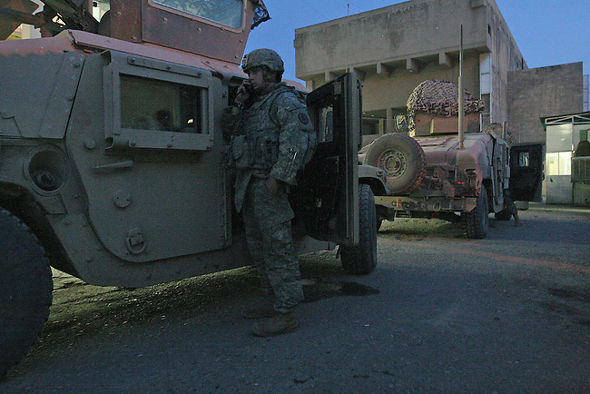 Staff Sgt. Chad Caldwell, 24, of Spokane, Wash., talks on the radio with superiors in Mosul, Iraq while waiting to escort an ambulance with a wounded Iraqi officer to the military hospital at nearby Forward Operating Base Marez. Caldwell, a soldier with Troop K, 3rd Squadron, 3rd Armored Cavalry Regiment, was killed in action almost two months after this photo was taken, when an insurgent bomb exploded near his dismounted patrol. March 8, 2008. DREW BROWN/STARS AND STRIPES