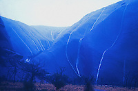 A rare rainstorm over Ayers Rock, Uluru in Central Australia, this image was taken at almost nightfall.