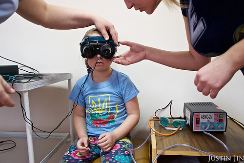 Julia, 6, is treated for her cross-eyes at the Zhitomyr hospital in Ukraine. <br /> <br /> Her grandparents received radiation exposure during the nuclear disaster in the Chernobyl power station disaster happened on 26 April 1986. <br /> <br /> 30 years on, the area is still too heavily contaminated for human activity.