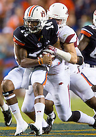HAWGS ILLUSTRATED JASON IVESTER --08/30/2014--<br /> Arkansas sophomore linebacker Brooks Ellis tackles Auburn senior quarterback Nick Marshall on Saturday, Aug. 30, 2014, against Auburn at Jordan-Hare Stadium in Auburn, Ala.