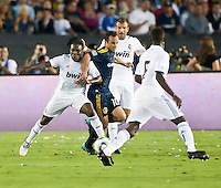 Galaxy forward Landon Donovan (10) battles Real midfielder Royston Ricky Drenthe (15) during the first half of the friendly game between LA Galaxy and Real Madrid at the Rose Bowl in Pasadena, CA, on August 7, 2010. LA Galaxy 2, Real Madrid 3.