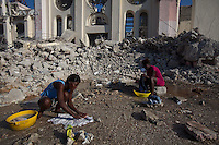 Women wash clothing and linens at the heavily damaged National Cathedral in Port-au-Prince. The 7.0 earthquake that devastated parts of Haiti on January 12 killed hundreds of thousands of people. January's earthquake killed hundreds of thousands of people and caused significant and lasting structural and economic damage in the Caribbean nation.