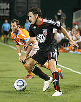 Carlos Verela #11 of D.C. United pushes the ball away from Brad Davis #11 of the Houston Dynamo during an MLS match at RFK Stadium in Washington D.C. on September  25 2010. Houston won 3-1.