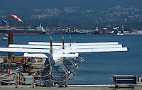 Three seaplanes tied up at dock in Coal Harbor Vancouver