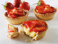 strawberry and custard tarts. Food photos.