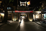 Motorbikes pass through one of the few surviving gates that lead into the Old Quarter of Hanoi, Vietnam. Nov. 4, 2012.