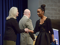 NWA Democrat-Gazette/BEN GOFF @NWABENGOFF<br /> Aries Sanders, a sophomore at Rogers Heritage High, shakes hands with Darla Tomasko, assistant principal at Rogers Heritage High School, as she walks the stage to receive her certificate of enrollment Sunday, Feb. 12, 2017, during an induction ceremony for the inaugural class of the Rogers Honors Academy at Rogers High School.