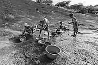 Fulani girls  doing the washing up. Kajuru, North-western Nigeria.