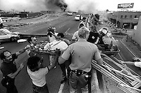 Oakland, Ca,  Oct 17, 1989 The Cypress freeway is collapsed during the Loma Prieta earthquake.<br />Survivor is taken off the top of the double deck structure. 9photo by Miichael Macor/Oakland Tribune)