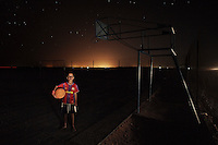 Ayub Ahmed Mohamed, 10, in El Aaiún refugee camp, Algeria, wearing his favourite Barcelona jersey...I like learning Spanish. I was in Spain three times. I went with many Saharawi kids but I lived with a Spanish family.  Barcalona FC are my favourite thing in the world, they are the best team. I went to the Nou camp in Barcelona to see them play. It's a nice stadium. It was raining, they were playing Manchester United. It was full I couldn't see an empty seat. Barca won 2-0 . Xavi passed to Messi and he headed it into the goal. I jumped in air and we were screaming. This summer I saw Ibrahimovic. I wanted Eto to stay at Barca because he was the best striker in the world. Now Messi is. Ibrahimovic is cross-eyed. ..Real Madrid don't know how to play, Inter Milan beat them 3-2. Even with Kaka and Ronaldo Barca will beat them. Cristiano [Ronaldo] cannot play for a long time. When the others take the ball from Kaka he always falls over. Only one of my friends supports Real all the others support Barca. If I see another boy with a Real shirt I will rip it. I once stole my brothers Real shirt and threw it away.  Sometimes we find photos of Real players and we burn them. ..In the morning it is cold and we have to wear a lot of clothes but later it's hot. I hate the garbage lying around. I would like to go back to my land.