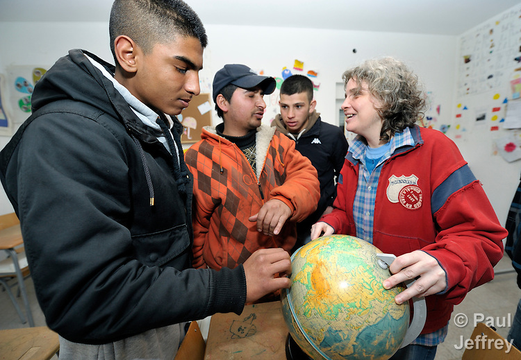 Teacher Suzana Aleksic uses a globe to teach geography to participants in a basic literacy class for Roma adults in the Zemun Polje neighborhood of Belgrade, Serbia. The program is sponsored by the Branko Pesic School, which is supported by Church World Service. Many of the participants are refugees from Kosovo. Many lack legal status in Serbia, and thus have difficulty obtaining formal employment and accessing government services.