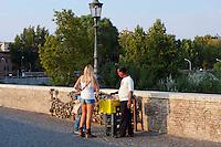 """Roma  7 Settembre 2012.Ponte Milvio. Lucchetti d'amore.Uno dei più antichi ponti della Città Eterna, è diventato un simbolo importante per i moderni Romeo e Giulietta.Fanno il loro pellegrinaggio sull'antico ponte romano e sigillano il loro amore mettendo un lucchetto e gettano la chiave nel Tevere. La tradizione dei Lucchetti d'amore ha iniziato con la pubblicazione di un libro """"Tre Metri Sopra Il Cielo"""" , scritto da  Federico Moccia. Il venditore di lucchetti"""