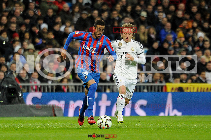Real Madrid´s Luka Modric and Levante UD´s Victor Camarasa Ferrando during 2014-15 La Liga match between Real Madrid and Levante UD at Santiago Bernabeu stadium in Madrid, Spain. March 15, 2015. (ALTERPHOTOS/Luis Fernandez) /NORTEphoto.com