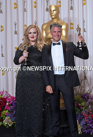 Adele and Paul Epworth.OSCARS Backstage- 85th Annual Academy Awards, Dolby Theatre, Hollywood_24/02/2013.MANDATORY PHOTO CREDIT: ©Ampas/NEWSPIX INTERNATIONAL . .(Failure to by-line the photograph will result in an additional 100% reproduction fee surcharge. You must agree not to alter the images or change their original content)..            *** ALL FEES PAYABLE TO: NEWSPIX INTERNATIONAL ***..IMMEDIATE CONFIRMATION OF USAGE REQUIRED:Tel:+441279 324672..Newspix International, 31 Chinnery Hill, Bishop's Stortford, ENGLAND CM23 3PS.Tel: +441279 324672.Fax: +441279 656877.Mobile: +447775681153.e-mail: info@newspixinternational.co.uk