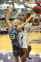 NWA Democrat-Gazette/ANDY SHUPE<br /> Rogers forward Madison Sherrill (23) and Fayetteville guard Wyvete Mayberry collide Friday, Feb. 10, 2017, while reaching for a loose ball during the second half of play in Bulldog Arena. Visit nwadg.com/photos to see more photographs from the game.