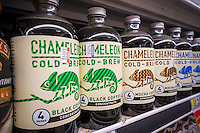 Bottles of Chameleon brand cold brewed coffee in a supermarket cooler in New York on Monday, August 3, 2015. As cold brewed coffee moves away from its hipster roots into the mainstream it is being offered by more and more coffee chains. It can also boost summer coffee sales, traditionally coffee drinking falls off in the hot months.  (© Richard B. Levine)