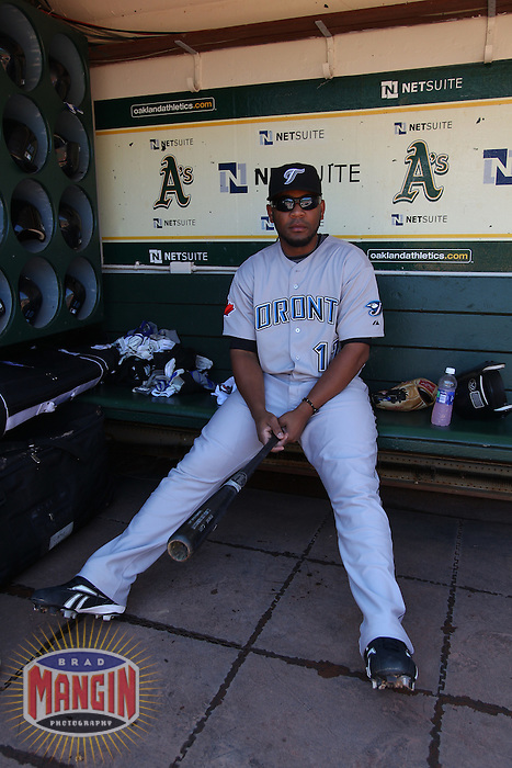 OAKLAND, CA - AUGUST 18:  Edwin Encarnacion #12 of the Toronto Blue Jays gets ready in the dugout before the game against the Oakland Athletics at the Oakland-Alameda County Coliseum on August 18, 2010 in Oakland, California. Photo by Brad Mangin