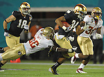 Seminoles linebacker Telvin Smith (22) brings down George Atkinson III (34) on a kick return.