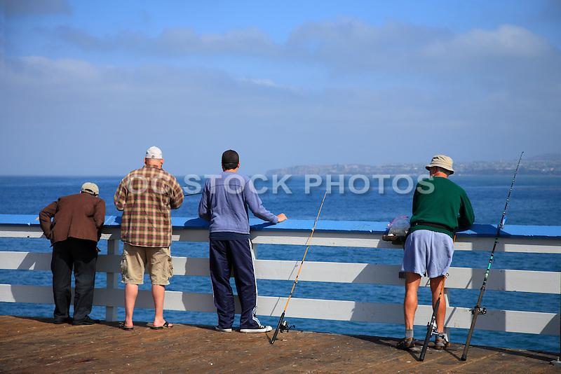 Men fishing off the san clemente pier socal stock photos for Dana point pier fishing