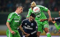 FUSSBALL   1. BUNDESLIGA    SAISON 2012/2013    15. Spieltag   VfL Wolfsburg - Hamburger SV                               02.12.2012 Ivica Olic (li) und Simon Kjaer (re, beide VfL Wolfsburg) gegen Milan Badelj (Mitte, Hamburger SV)