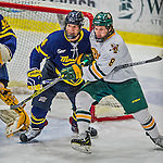 21 February 2015:  Merrimack College Warrior Defenseman Marc Biega, a Freshman from Pointe-Claire, Quebec, keeps University of Vermont Catamount Forward Jonathan Turk, a Junior from Calgary, Alberta, out of the crease during first period action at Gutterson Fieldhouse in Burlington, Vermont. The teams played to a scoreless tie as the Cats wrapped up their Hockey East regular home season. Mandatory Credit: Ed Wolfstein Photo *** RAW (NEF) Image File Available ***