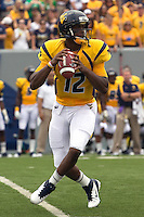 WVU quarterback Geno Smith. The WVU Mountaineers beat the Marshall Thundering Herd 34-13 in a game called just after the fourth quarter started because of severe thunderstorms in the area. The game was played at Milan Puskar Stadium in Morgantown, West Virginia on September 4, 2011.
