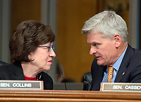 United States Senators Susan Collins (Republican of Maine), left, and Bill Cassidy (Republican of Louisiana) right, have a discussion during the confirmation hearing for R. Alexander Acosta, Dean of Florida International University College of Law and US President Donald J. Trump's nominee for US Secretary of Labor  before the US Senate Committee on Health, Education, Labor &amp; Pensions on Capitol Hill in Washington, DC on Wednesday, March 22, 2017.<br /> Credit: Ron Sachs / CNP /MediaPunch