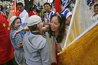 Chinese woman hugs a Jewish boy at the Jerusalem`s annual parade.Thousands of Christian Evangelists attend a parade in the center of Jerusalem, marking the Jewish holiday of Sukkot or the Feast of the Tabernacles. Sep 24, 2013. Photo by Oren Nahshon