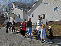 Families leave the Sago Baptist church near Buckhannon, WV, Sunday, Jan. 8, 2005, after services. Twelve miners were killed in a mine explosion at the Sago mine near the church. (Gary Gardiner/EyePush Newsphotos)<br />