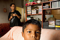 A boy that has a minor learning deficiency problem and his grandmother at their apartment, a family of three adults and two boys.