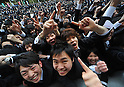 February 8, 2012, Tokyo, Japan - A throng of professional school students swarms to the stage at the climax of a send-off rally on Wednesday, February 8, 2012...Although Japans jobless rate in December 2011 improved 0.1 point from November to 4.6 percent, still 2.75 million Japanese are jobless. An estimated 203,000 students are due to graduate professional schools in March, of which roughly 52 percent have found some kind of jobs or another, according to the government stats. (Photo by Natsuki Sakai/AFLO) AYF -mis-.