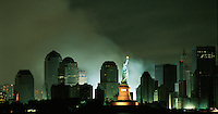 New York. 9/11/ 01 Attack Liberty New York. Statue of Liberty and lower Manhattan after attack on the World Trade Center Sep 11, 2001, .Pages 126-127: These United States Book