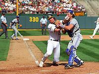 Baseball: Oakland Athletics Mark McGwire and Toronto Blue Jays Pat Borders in action during the ALCS. Oakland, CA 10/8/1992 MANDATORY CREDIT: Brad Mangin/Sports Illustrated