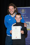 St Johnstone FC Youth Academy Presentation Night at Perth Concert Hall..21.04.14<br /> Stevie May presents to Kieran Forbes<br /> Picture by Graeme Hart.<br /> Copyright Perthshire Picture Agency<br /> Tel: 01738 623350  Mobile: 07990 594431