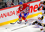 22 November 2008: Montreal Canadiens' right wing forward Tom Kostopoulos in action against the Boston Bruins during the second period at the Bell Centre in Montreal, Quebec, Canada.  After a 2-2 regulation tie and a non-scoring 5-minute overtime period, the Boston Bruins scored the lone shootout goal thus defeating the Canadiens 3-2. The Canadiens, celebrating their 100th season, honored former Montreal goaltender Patrick Roy, and retired his jersey (Number 33) during pre-game ceremonies. ***** Editorial Use Only *****..Mandatory Photo Credit: Ed Wolfstein Photo *** Editorial Sales through Icon Sports Media *** www.iconsportsmedia.com