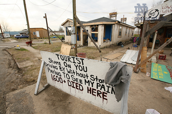 A Lower Ninth Ward resident displays this sign scolding so-called 'disaster tourists.'