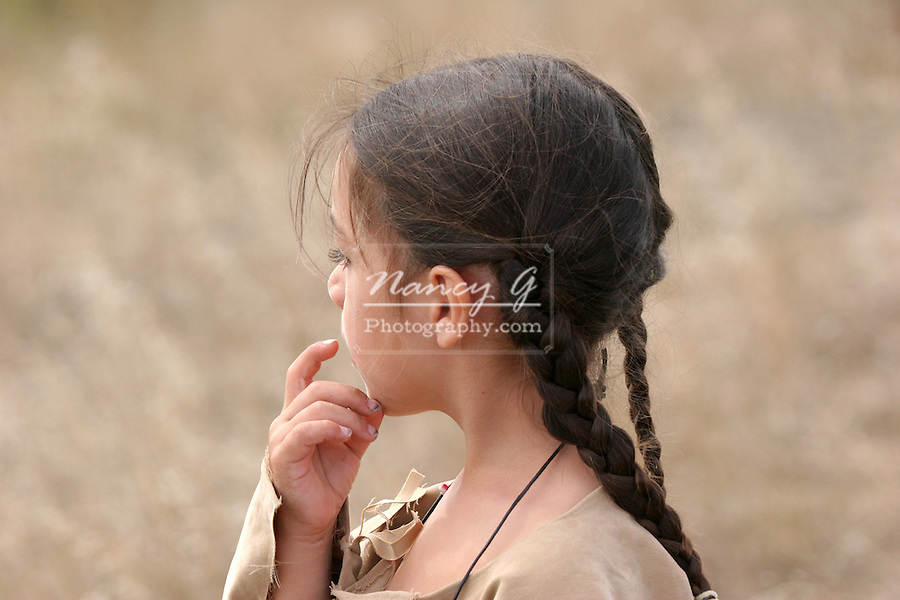 A young Native American Sioux Indian boy in South Dakota during the fall season thinking