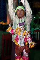 Myanmar, Burma. Bagan.  Burmese Marionette and its Operator.  Banknotes are pinned to the marionette as a sign that tips are welcome.