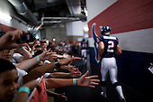 Houston, Texas<br /> October 2, 2011<br /> <br /> The players leave the locker-room and shakes the hands of fans before going on to the field to begin the game. <br /> <br /> The Houston Texans defeated the Pittsburgh Steelers at the Reliant Stadium 17 to 10.