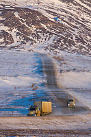 Semi tractor trailer trucks haul supplies along the James Dalton Highway in Alaska's Arctic.