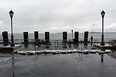 New York, New York.October 30, 2012..Sandbags strewn around Battery Park, unable to sustain the blast of Hurricane Sandy.