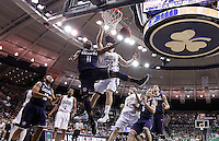 SOUTH BEND, IN - JANUARY 12: Ryan Boatright #11 of the Connecticut Huskies shoots under the basket as Pat Connaughton #24 of the Notre Dame Fighting Irish defends at Purcel Pavilion on January 12, 2012 in South Bend, Indiana. (Photo by Michael Hickey/Getty Images) *** Local Caption *** Ryan Boatright ; Pat Connaughton