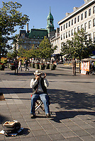 French Canadian harmonica player in Place Jacques Cartier, Old Montreal, Quebec, Canada