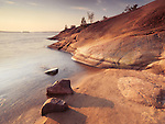 Beautiful landscape nature scenery of Georgian Bay red rocky shore at dawn. Killbear Provincial Park, Ontario, Canada.