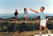 United States President George H.W. Bush pitches horseshoes as his grandchildren look on at Walker's Point in Kennebunkport, Maine on August 8, 1991.<br /> Mandatory Credit: David Valdez / White House via CNP
