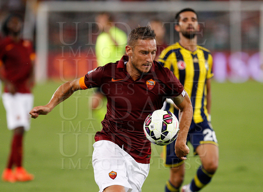 Calcio, amichevole Roma vs Fenerbahce. Roma, stadio Olimpico, 19 agosto 2014.<br /> Roma forward Francesco Totti in action during the friendly match between AS Roma and Fenerbahce at Rome's Olympic stadium, 19 August 2014.<br /> UPDATE IMAGES PRESS/Riccardo De Luca