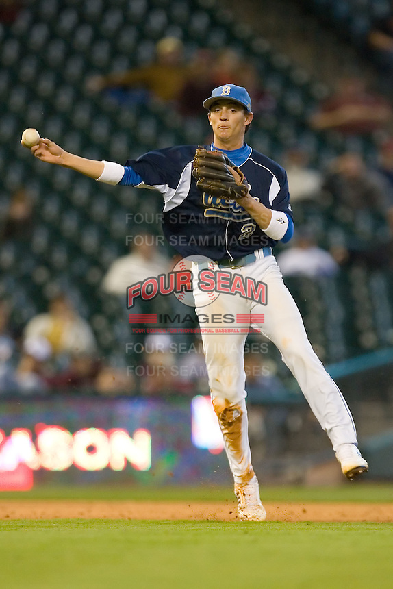 Shortstop Niko Gallego #2 of the UCLA Bruins makes an off balance throw to first base versus the Baylor Bears  in the 2009 Houston College Classic at Minute Maid Park February 28, 2009 in Houston, TX.  The Bears defeated the Bruins 5-1. (Photo by Brian Westerholt / Four Seam Images)