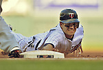 29 September 2012: Minnesota Twins infielder Jamey Carroll dives safely back to first during game action against the Detroit Tigers at Target Field in Minneapolis, MN. The Tigers defeated the Twins 6-4 in the second game of their 3-game series. Mandatory Credit: Ed Wolfstein Photo